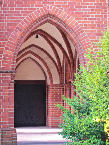 Series of arches leading to a door to the interior - focus on self-examination