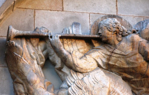 Relief of angel with trumpet in Barcelona - symbolising the announcement of spirituality events