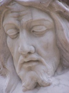 Sadness of Jesus statue in cemetery - focus for meditation on fasting